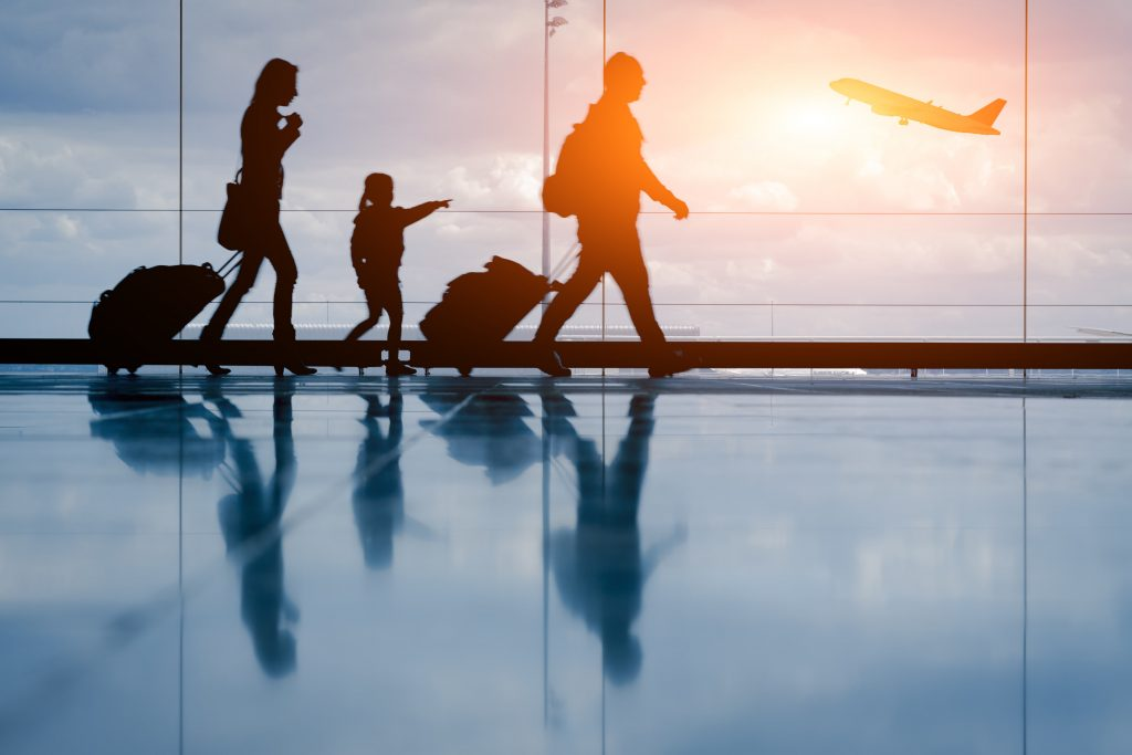 Holiday Travel Tips - Family in an Airport